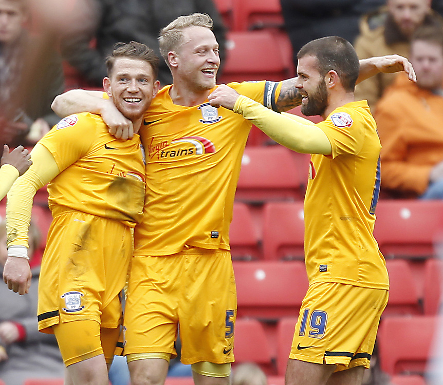 Preston North End's Joe Garner celebrates scoring his sides first goal with his team mates<br /> <br /> Photographer Mick Walker/CameraSport<br /> <br /> Football - The Football League Sky Bet League One - Barnsley v Preston North End - Saturday 21st March 2015 - Oakwell Stadium - Barnsley<br /> <br /> © CameraSport - 43 Linden Ave. Countesthorpe. Leicester. England. LE8 5PG - Tel: +44 (0) 116 277 4147 - admin@camerasport.com - www.camerasport.com