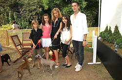JADE JAGGER with her daughters ASSISI and AMBA, DAN WILLIAMS and his son TAI WILLIAMS with their dogs at the Macmillan Cancer Support Dog Day held in the gardens of the Royal Hospital, Chelsea, London on 4th July 2006.<br /><br />NON EXCLUSIVE - WORLD RIGHTS