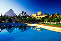 The Pyramids seen from the swimming pool of the Mena House Oberoi Hotel, Giza (near Cairo), Egypt