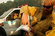 5 May 2009 - Santa Barbara, CA -  US Forest Service Hot Shot teams track the Jesusita fire as it burns near homes in the foothills of Santa Barbara, California. Photo Credit: Rod Rolle/Sipa Press,  21 August 2009-Santa Barbara, CA: