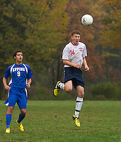 Pittsfield's Tyler Stockman and Epping's Jake West during Wednesday's NHIAA Division IV soccer match at Drake Field.  (Karen Bobotas/for the Concord Monitor)