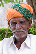 India, Rajasthan, chittorgarh the fort close up portrait of a mature local man with a colourful turban
