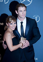 © Licensed to London News Pictures. 06/02/2012. London, UK. Actress Elsa Pataky and Chris Hemsworth arriving on the red carpet for the Laureus World Sports Awards 2012. Dozens of sports and Hollywood celebrities arrived in the English capital to attend the event held at the Queen Elizabeth II Conference Centre in the same year that London will host the Olympic Games. Photo credit : Ben Cawthra/LNP