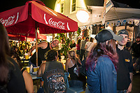 """Biketemberfest brought a crowd enjoying the open """"block party"""" atmosphere at Weirs Beach Saturday night.  (Karen Bobotas/for the Laconia Daily Sun)"""