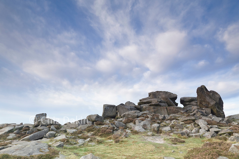 The knobbly gritstone outcrops of Over Owler Tor under streaky cloud.