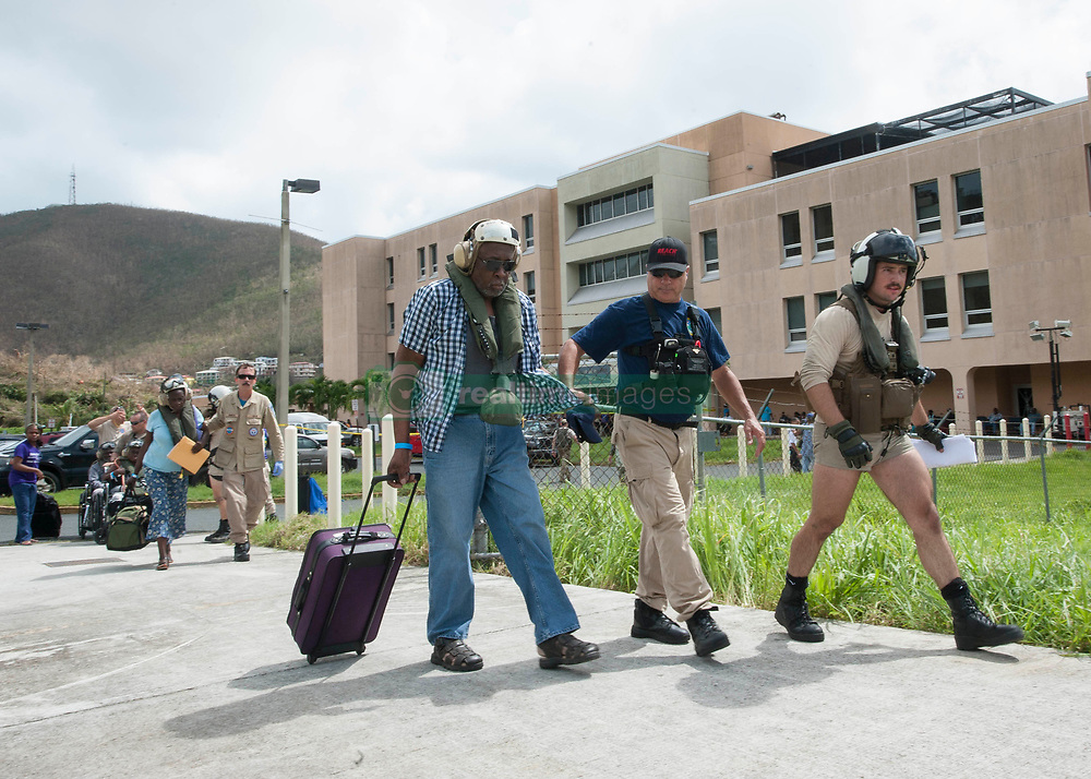 170909-N-NM806-050 <br /> ST. THOMAS, U.S. Virgin Islands (Sept. 9, 2017) Sailors and members of the National Disaster Medical Assistance Team prepare residents for evacuation as part of first response efforts to the U.S. Virgin Islands in the wake of Hurricane Irma. The Department of Defense is supporting the Federal Emergency Management Agency, the lead federal agency, in helping those affected by Hurricane Irma to minimize suffering and is one component of the overall whole-of-government response effort. (U.S. Navy photo by Mass Communication Specialist Seaman Taylor King/Released)