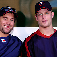 24 August 2007:  Minnesota Twins third baseman Nick Punto (8) and first baseman Justin Morneau (33) sit on the bench prior to the game against the Baltimore Orioles.  The Twins defeated the Orioles 7-4 at Camden Yards in Baltimore, MD.   ****For Editorial Use Only****