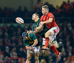 Gareth Anscombe of Wales fails to claim the high ball under pressure from Malcolm Marx of South Africa<br /> <br /> Photographer Simon King/Replay Images<br /> <br /> Under Armour Series - Wales v South Africa - Saturday 24th November 2018 - Principality Stadium - Cardiff<br /> <br /> World Copyright © Replay Images . All rights reserved. info@replayimages.co.uk - http://replayimages.co.uk