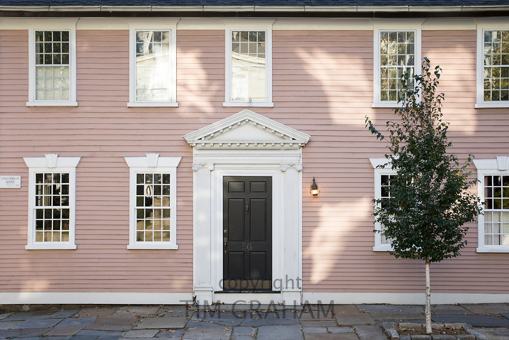 Wooden clapboard period house with elegant porch and front door on Benefit Street in Providence, Rhode Island, USA