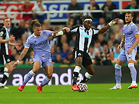 NEWCASTLE UPON TYNE, ENGLAND - SEPTEMBER 17: Kalvin Phillips of Leeds United and Allan Saint-Maximin of Newcastle United during the Premier League match between Newcastle United and Leeds United at St. James Park on September 17, 2021 in Newcastle upon Tyne, England. (Photo by MB Media)