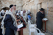 Jewish worshippers say their prayers at the Western Wall, in Old City, Jerusalem, Israel.