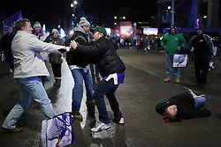 February 4, 2018 - Minneapolis, MN, USA - A pair of men fight as a third man tries to break them up while another man lays unconscious on the ground during a fight as fans left U.S. Bank Stadium after Super Bowl LII on Sunday, Feb. 4, 2018 in Minneapolis, Minn. (Credit Image: © Anthony Souffle/TNS via ZUMA Wire)
