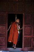 Young monk visiting Mandalay Palace, Burma.<br />