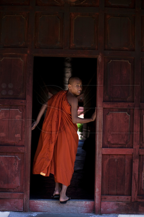 Young monk visiting Mandalay Palace, Burma.<br /> Note: These images are not distributed or sold in Portugal