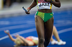 Athlete of Jamaica competes during the women's 4x100m relay race of the 12th IAAF World Athletics Championships at the Olympic Stadium on August 22, 2009 in Berlin, Germany. (Photo by Vid Ponikvar / Sportida)