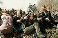 14 APR 1996 DANNENBERG/GERMANY:<br /> Jugendliche Demonstranten blockieren die Bahnstrecke vor der Castor Verladestation Dannenberg, die Polizei reagiert mit Wasserwerfereinsatz<br /> IMAGE: 19960414-01/02-09<br /> KEYWORDS: Demo, Polizei, police, Demonstrant, demonstrator, Gewalt, violence, Gorleben, Schiene, Kernkraft, Atomkraft, Kernkraftgegner, Gewalt, violence