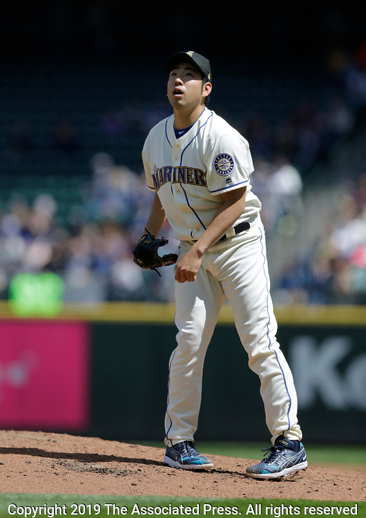 Seattle Mariners starting pitcher Yusei Kikuchi watches the flight of a fly ball against the Minnesota Twins during a baseball game, Sunday, May 19, 2019, in Seattle. The Mariners went on to win 7-4. (AP Photo/John Froschauer)