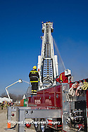 63818-02306 Firefighters extinguishing warehouse fire using aerial ladder truck, Salem, IL