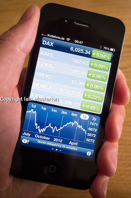 Looking at stockmarket data using an app on an iPhone smartphone