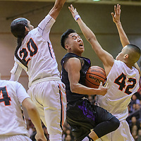 Gallup Bengals Quincy Smith (20), left, and Asa Holyan (42) cut off Miyamura Patriot Presley Nelson (25) on a drive to the basket in the district 1-5A tournament game at Gallup High School Wednesday. The Bengals outlasted the Patriots with a 41-38 win.