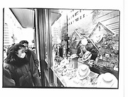 Shopper wearing a surgical mask  on Madison Ave. New York. 1993 approx. © Copyright Photograph by Dafydd Jones 66 Stockwell Park Rd. London SW9 0DA Tel 020 7733 0108 www.dafjones.com