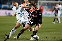 FOOTBALL - FRENCH CHAMPIONSHIP 2009/2010 - L1 - OLYMPIQUE MARSEILLE v FC LORIENT - 7/03/2010 - PHOTO PHILIPPE LAURENSON / DPPI - BENOIT CHEYROU (OM) / SEBASTIAN DUBARBIER (LOR)