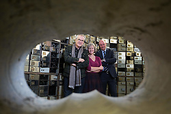 EDITORIAL USE ONLY<br /> Actor Larry Lamb (left) talks with Museum of London curator Jackie Keily and former police commander Peter Spindler at the Hatton Garden Safe Deposit, in Hatton Garden, London, which was at the centre of a high profile heist in 2015 by a gang of career criminals who stole £14 million worth of jewels.