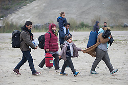 October 24, 2016 - Calais, Calais, France - Calais , France . People including children leaving the Jungle migrant camp in Calais , Northern France , with their parents , on the day of a planned eviction and start of the destruction of the camp  (Credit Image: © Joel Goodman/London News Pictures via ZUMA Wire)