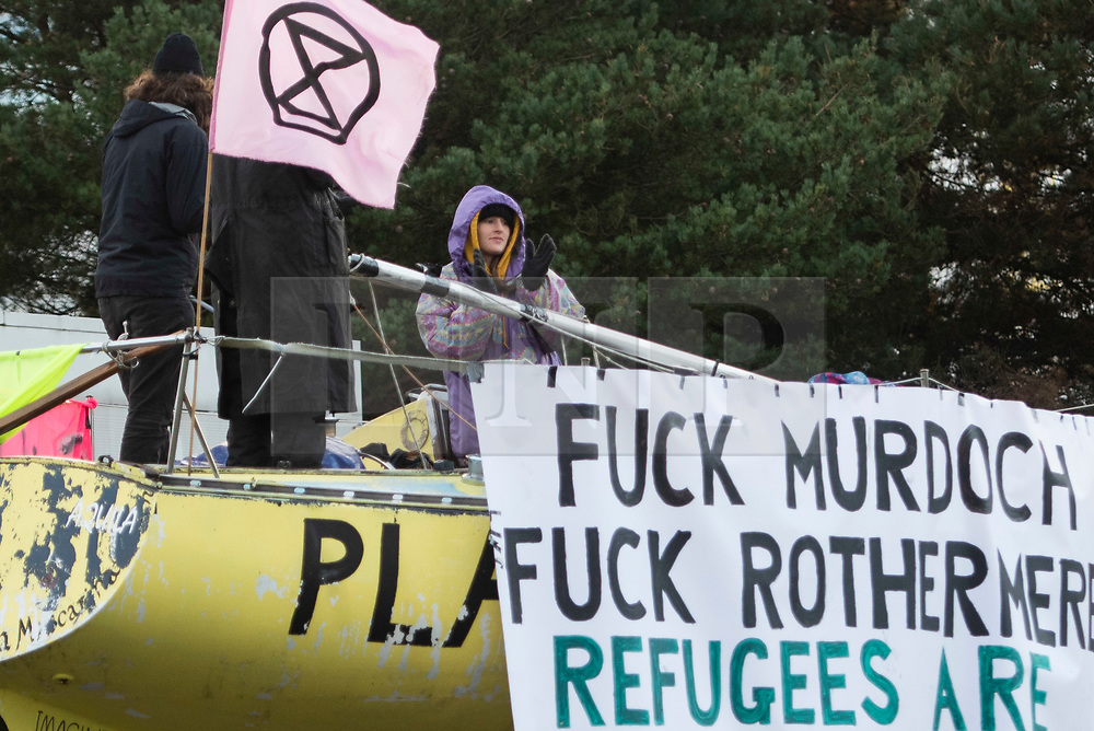 © Licensed to London News Pictures. 05/09/2020. Knowsley, UK. A protestor cheers support for those arrested as extinction Rebellion block the road in Knowsley, Liverpool to prevent papers going to print at a News Corp plant. Photo credit: Kerry Elsworth/LNP