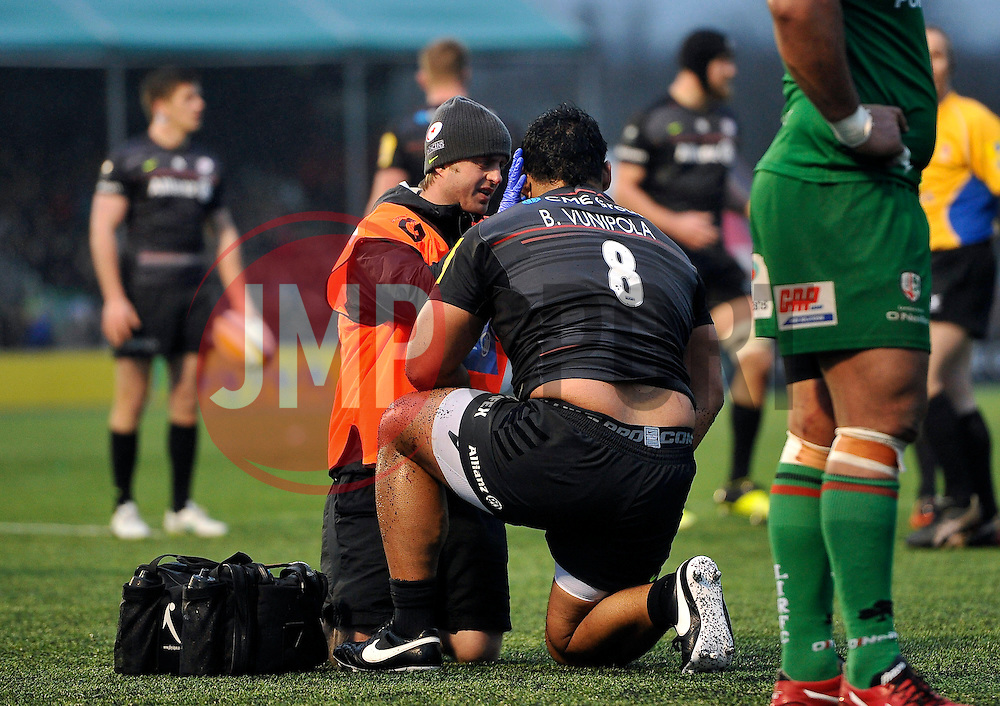 Billy Vunipola of Saracens is treated for an injury during a break in play - Photo mandatory by-line: Patrick Khachfe/JMP - Mobile: 07966 386802 03/01/2015 - SPORT - RUGBY UNION - London - Allianz Park - Saracens v London Irish - Aviva Premiership