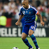 14 October 2008: French forward and captain Thierry Henry #12 dribbles the ball during the friendly football match won 3-1 by France over Tunisia on October 14, 2008, at the Stade de France in Saint-Denis, near Paris, France.