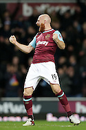 James Collins of West Ham United celebrates after the final whistle. The Emirates FA cup, 4th round replay match, West Ham Utd v Liverpool at the Boleyn Ground, Upton Park  in London on Tuesday 9th February 2016.<br /> pic by John Patrick Fletcher, Andrew Orchard sports photography.