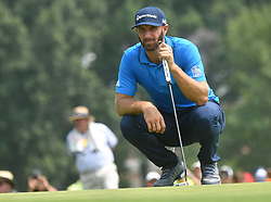 August 12, 2018 - St. Louis, Missouri, U.S. - ST. LOUIS, MO - AUGUST 12: Dustin Johnson lines up his putt on the #1 green during the final round of the PGA Championship on August 12, 2018, at Bellerive Country Club, St. Louis, MO.  (Photo by Keith Gillett/Icon Sportswire) (Credit Image: © Keith Gillett/Icon SMI via ZUMA Press)