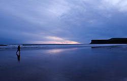 © Licensed to London News Pictures.09/02/16<br /> Saltburn-by-the-Sea, UK. <br /> <br /> A man takes an early morning walk along the beach at first light at Saltburn by the Sea in North Yorkshire.<br /> <br /> Photo credit : Ian Forsyth/LNP
