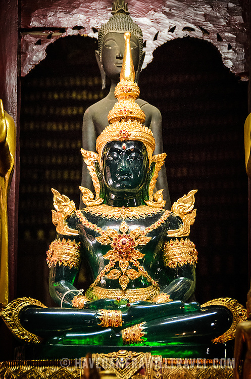 The famous Jade Buddha at Wat Mai Suwannaphumaham.  Wat Mai, as it is often known, is a Buddhist temple in Luang Prabang, Laos, located near the Royal Palace Museum. It was built in the 18th century and is one of the most richly decorated Wats in Luang Prabang.