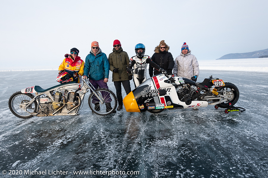 Russian custom bike builder Dima Golubchikov (yellow hat) of Zillers Garage with his twin engine Jawa and Belgian custom bike builder Brice Hennebert (red hat) with his Appaloosa 2018 Indian Scout Bobber racer, French pilot Sebastien Lorentz and their teams at the Baikal Mile Ice Speed Festival. Maksimiha, Siberia, Russia. Saturday, February 29, 2020. Photography ©2020 Michael Lichter.