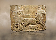 Photo of Hittite monumental relief sculpted orthostat stone panel. Limestone, Karkamıs, (Kargamıs), Carchemish (Karkemish), 900-700 B.C. Hunting carriage. Anatolian Civilisations Museum, Ankara, Turkey.<br /> <br /> Two human figures; one handling the carriage, the other throwing arrows. Both figures are wearing a headdress shaped like a skullcap. The dagger at the waist of the figure throwing arrow draws attention. There is an animal between the legs of the horse having an aigrette over its head.  <br /> <br /> Against a brown art background. .<br />  <br /> If you prefer to buy from our ALAMY STOCK LIBRARY page at https://www.alamy.com/portfolio/paul-williams-funkystock/hittite-art-antiquities.html  - Type  Karkamıs in LOWER SEARCH WITHIN GALLERY box. Refine search by adding background colour, place, museum etc.<br /> <br /> Visit our HITTITE PHOTO COLLECTIONS for more photos to download or buy as wall art prints https://funkystock.photoshelter.com/gallery-collection/The-Hittites-Art-Artefacts-Antiquities-Historic-Sites-Pictures-Images-of/C0000NUBSMhSc3Oo