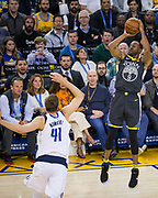 Golden State Warriors forward Andre Iguodala (9) shoots a jumper against the Dallas Mavericks at Oracle Arena in Oakland, California, on February 8, 2018. (Stan Olszewski/Special to S.F. Examiner)