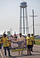"""Marchers in St. James Louisaina  heading toward the site of a proposed Formosa chemical plant on the third day of a five day march through Louisiana's 'Cancer Alley' held by the Coalition Against Death Alley. The Coalition Against Death Alley (CADA), is a group of Louisiana-based residents and members of various local and state organizations, is calling for a stop to the construction of new petrochemical plants and the passing of stricter regulations on existing industry in the area that include the groups RISE St. James, Justice and Beyond, the Louisiana Bucket Brigade, 350 New Orleans, and the Concerned Citizens of St. John  Louisiana's Cancer Alley, an 80-mile stretch along the Mississippi River, is also known as the """"Petrochemical Corridor,"""" where there are over 100 petrochemical plants and refineries"""