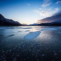 Snow on frozen lake Urvatnet, Lofoten Islands, Norway