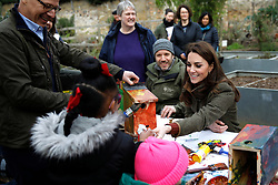 The Duchess of Cambridge helps make bird boxes during a visit to the King Henry's Walk Garden in Islington, London to learn about a project bringing people together through a shared love of horticulture.