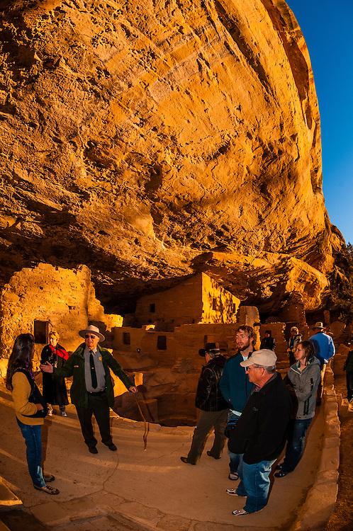 A park ranger giving a tour of Spruce Tree House, Mesa Verde National Park, Colorado USA