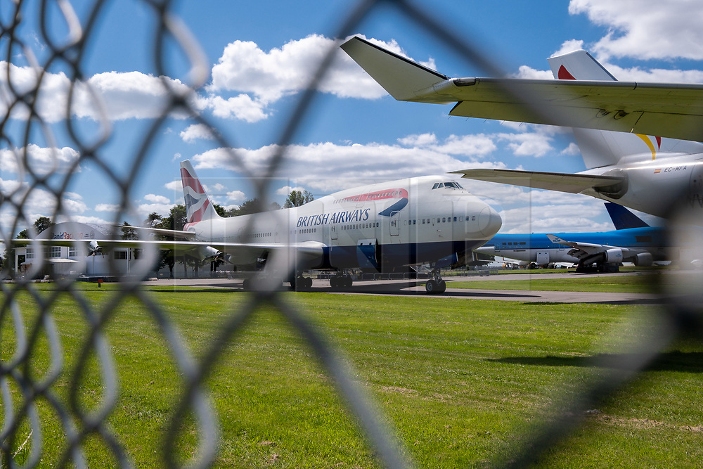 """© Licensed to London News Pictures 20/07/2020 - British Airways has recently announced the retirement of it's fleet of 747 aircraft, a decision brough forward due to the impact of the Coronavirus pandemic. This BA 747 is parked at Kemble airfield, Gloucestsertshire with It's engines allready removed. Based at the airfield """"Air Salvage international"""" dissasemble aircrfat for parts and scrap materials. Photo Credit : Stephen Shepherd/LNP"""