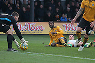 Newport County Goalkeeper Joe Day picks up the ball after defender Medy Elito managed to stop Yeovil's Conner Roberts. Skybet football league two match, Newport county v Yeovil Town at Rodney Parade in Newport, South Wales on Saturday 21st November 2015.<br /> pic by David Richards, Andrew Orchard sports photography.