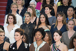 Sofia Boutella and Salma Hayek with other filmmakers on the steps of the red carpet in protest of the lack of female filmmakers honored throughout the history of the festival at the premiere of the film Les Filles du Soleil during the 71st Cannes Film Festival in Cannes, France on May 12, 2018. Photo by Julien Zannoni/APS-Medias/ABACAPRESS.COM