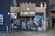 Old and graffiti covered boarded up entrance to St James House next to the O2 Academy on 30th March 2021 in Birmingham, United Kingdom. This property has been earmarked for redevelopment into a hotel, or has been described as an aparthotel and boutique hostel.