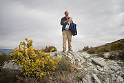 Parmenter Welty looks out holding a map on a hike through Las Alpujarras, Andalusia, Spain.