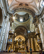 See the interior of Buenos Aires Metropolitan Cathedral (Catedral Metropolitana), the city's main Catholic church. It overlooks Plaza de Mayo in the city center, on the corner of San Martín and Rivadavia streets, in San Nicolás barrio, Buenos Aires, Argentina, South America. The Cathedral was rebuilt several times since its humble origins in the 1500s and now has a 1700s nave and dome and 1800s Neoclassical façade without towers. Panorama stitched from 2 overlapping photos.
