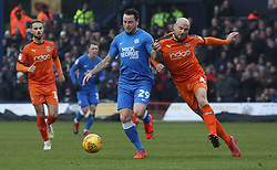 Lee Tomlin of Peterborough United in action with Alan McCormack of Luton Town - Mandatory by-line: Joe Dent/JMP - 19/01/2019 - FOOTBALL - Kenilworth Road - Luton, England - Luton Town v Peterborough United - Sky Bet League One