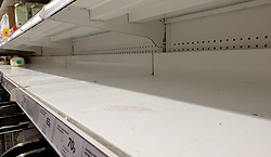 © Licensed to London News Pictures. 11/10/2021. London, UK. An emptily shelf of fresh milk in Sainsbury's, north London. This is amid fears of food shortages leading up to Christmas, due to labour shortages, following Brexit. Leading supermarkets may start rationing certain items ahead of Christmas. Photo credit: Dinendra Haria/LNP